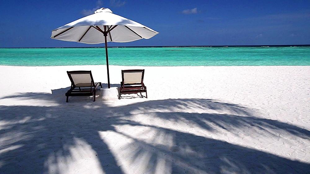 Sun lounger on beach in Maldives, Indian Ocean