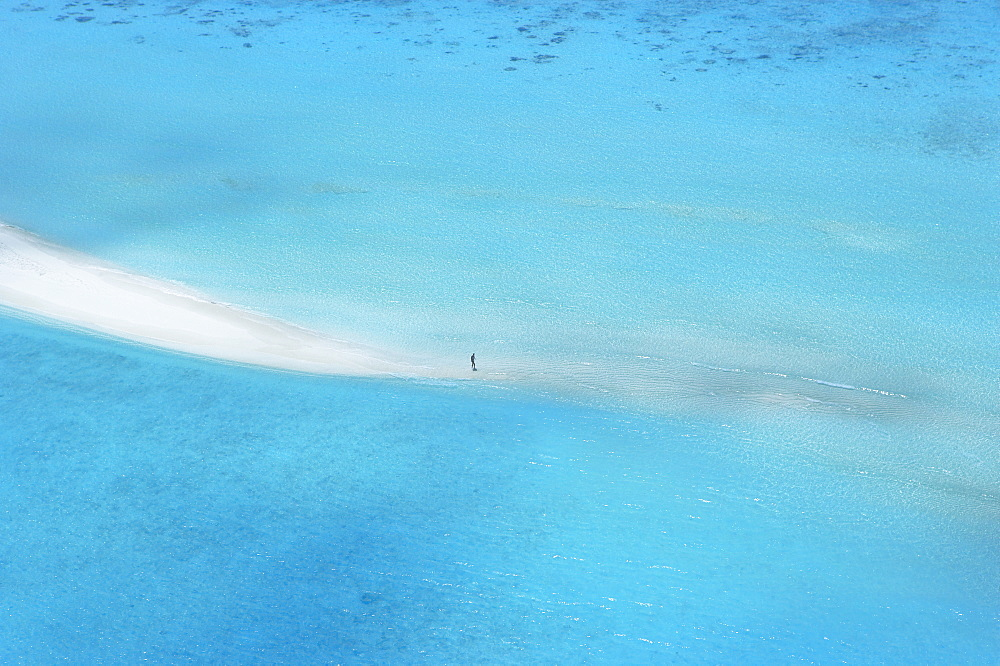 Sandbank in Maldives surrounded by blue water