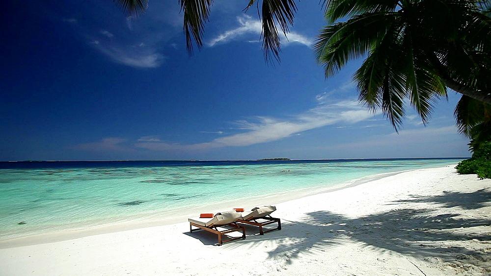 Tropical beach and sun loungers, Maldives, Indian Ocean