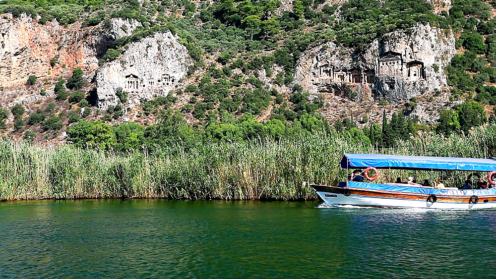Lycian tombs of Dalyan with tourist boat passing, Dalyan, Anatolia, Turkey, Asia Minor, Eurasia - 795-466