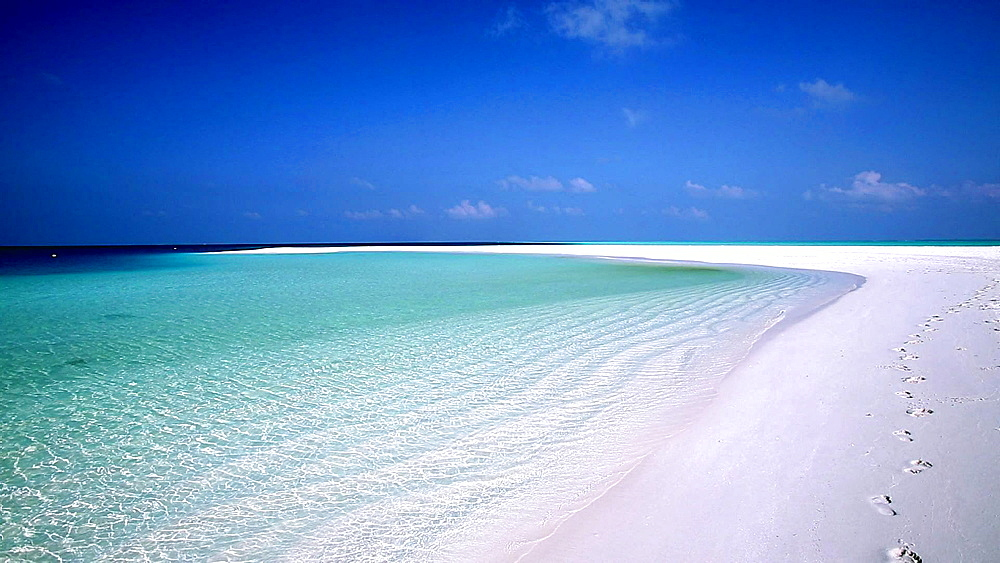 Footsteps on tropical beach, Maldives, Indian Ocean