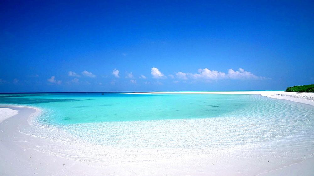 Tropical empty beach and lagoon, Maldives, Indian Ocean