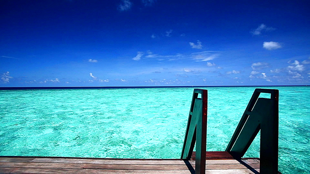 A ladder leading to a tropical lagoon, Maldives, Indian Ocean  - 795-546