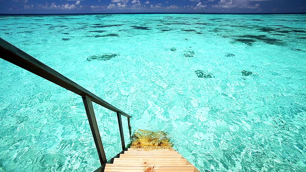 Ladder leading to the ocean, Maldives, Indian Ocean  - 795-552