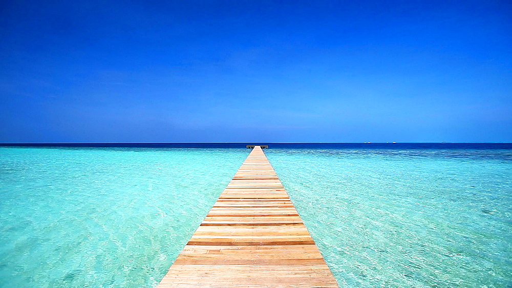 Wooden jetty leading out into the Indian Ocean, Maldives  - 795-556