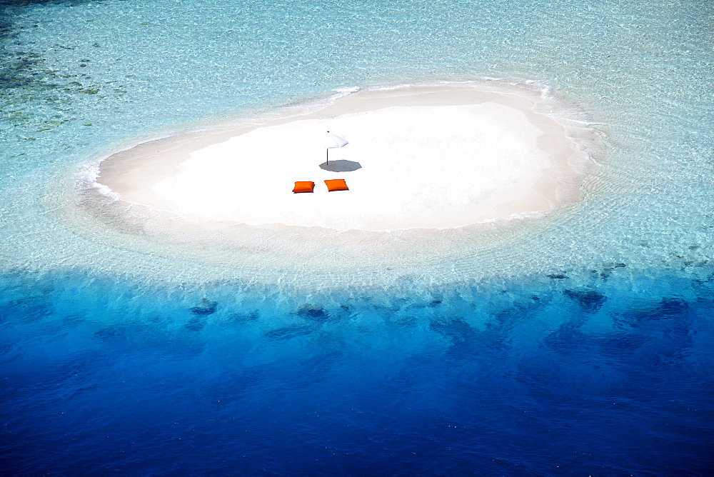 Aerial view of a sandbank, pillows and sun umbrella , Maldives, Indian Ocean, Asia