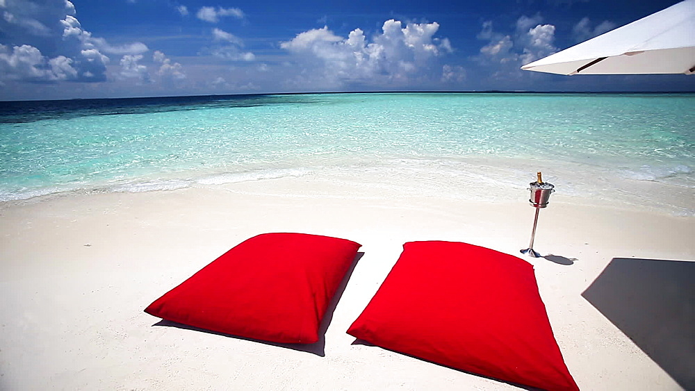 Tropical beach and red pillows, champagne and umbrella, Maldives, Indian ocean - 795-572