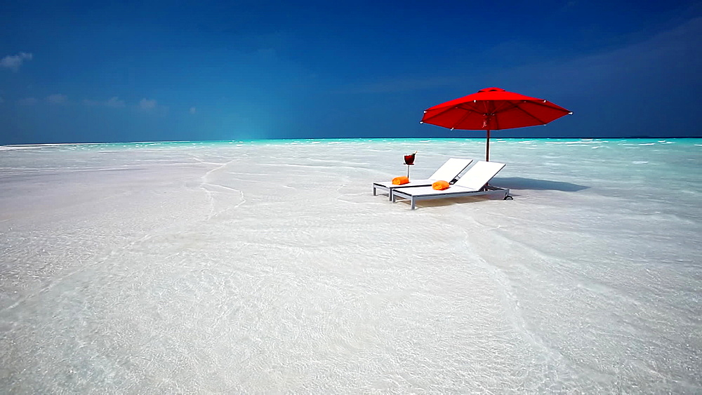 Lounge chairs on tropical beach, Maldives, Indian Ocean, Asia - 795-574