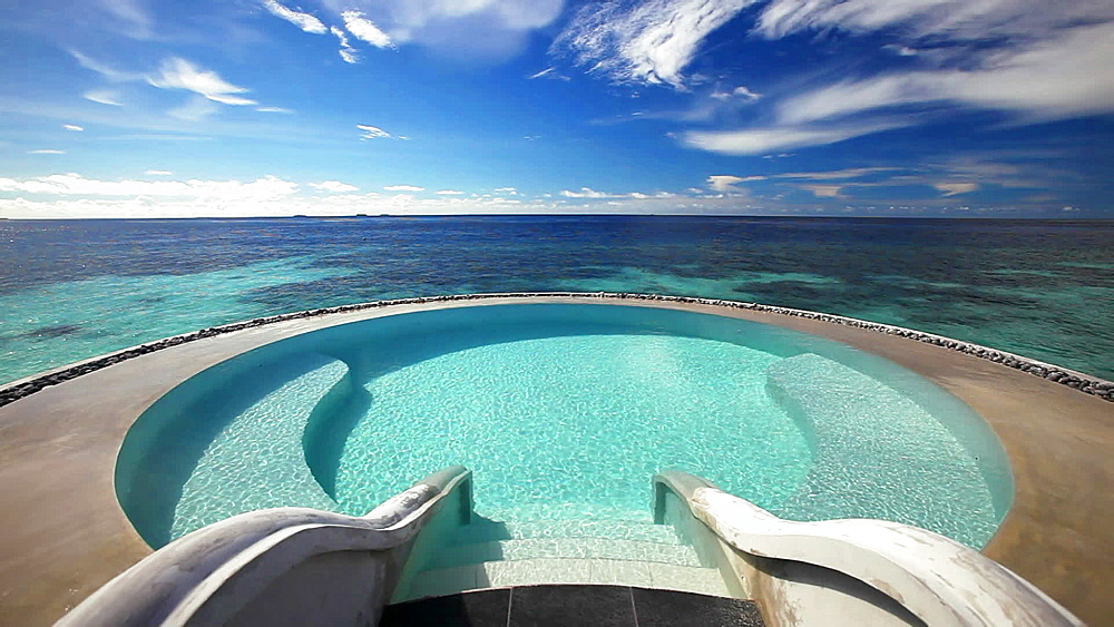 Infinity pool and tropical lagoon, Maldives, Indian Ocean - 795-576