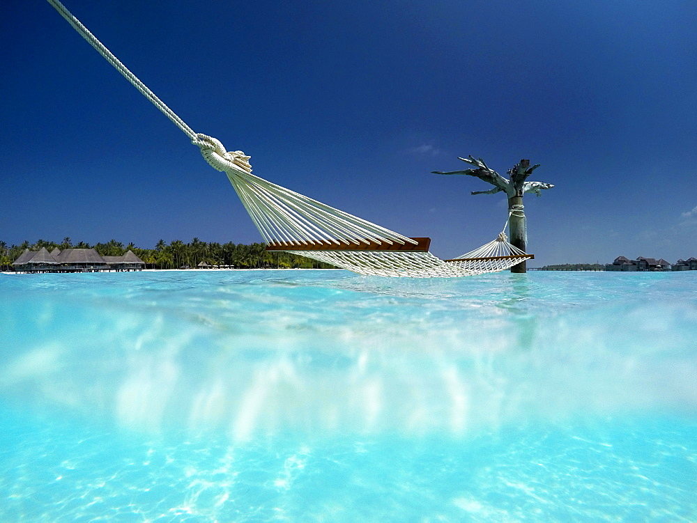Hammock in the lagoon at Gili Lankanfushi Resort, Maldives, Indian Ocean, Asia