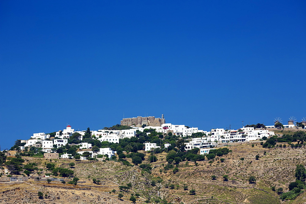 View of Chora town and Monastery of St. John the Evangelist, UNESCO World Heritage Site, Patmos Island, Greek Islands, Greece, Europe - 795-581