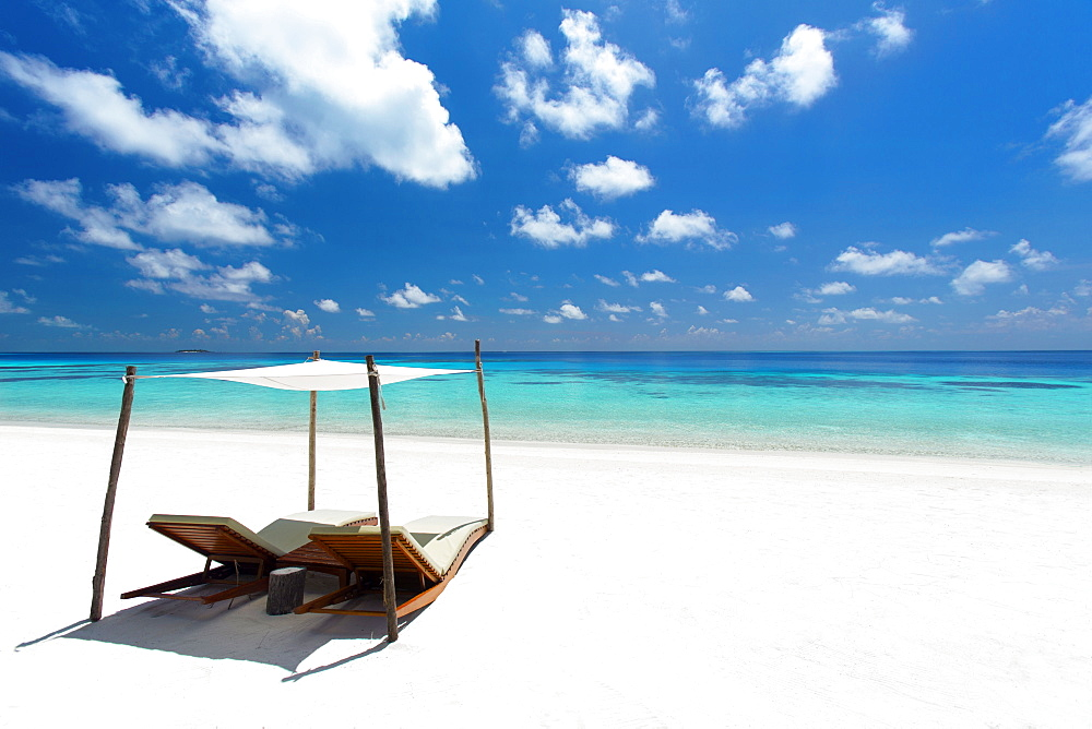 Lounge chairs on tropical white sandy beach, The Maldives, Indian Ocean, Asia