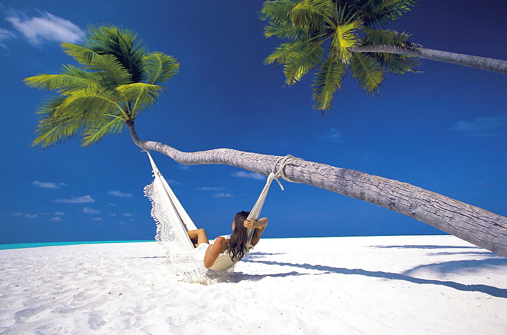 Woman in hammock on beach, Maldives, Indian Ocean, Asia - 795-72