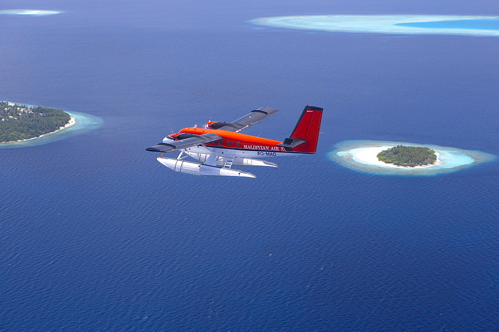 Aerial view of Maldivian air taxi flying above islands in the Maldives, Indian Ocean, Asia - 795-94