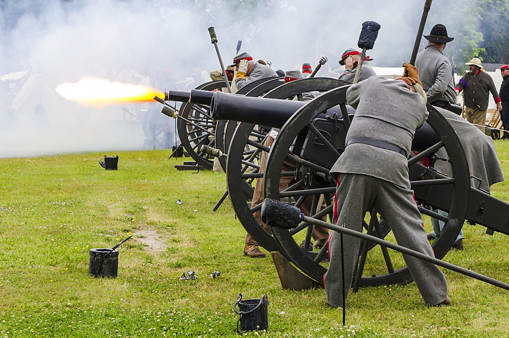 Confederate artillery unit cannon action during Thunder on the Roanoke Civil War reenactment in Plymouth, North Carolina, United States of America, North America