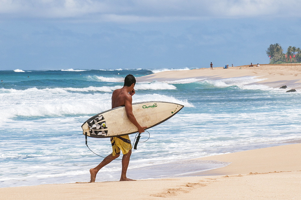 Surfing at Sunset Beach, North Shore, Oahu, Hawaii.