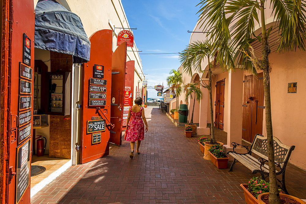 Woman walking by shop in downtown Charlotte Amalie, St. Thomas, US Virgin Islands, Caribbean