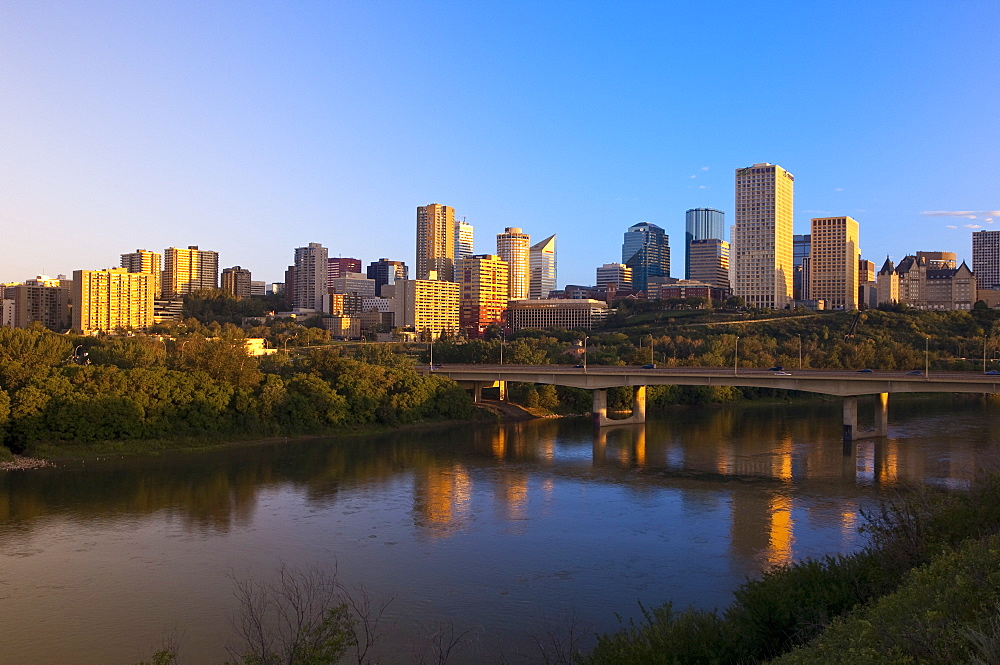 City at sunrise with the Saskatchewan River in foreground, Edmonton, Alberta, Canada, North America