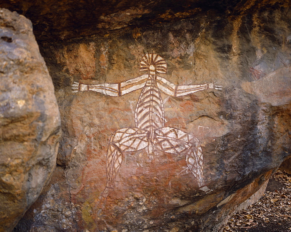 Aboriginal rock painting on red and black rock face, Kakadu National Park, Northern Territory, Australia