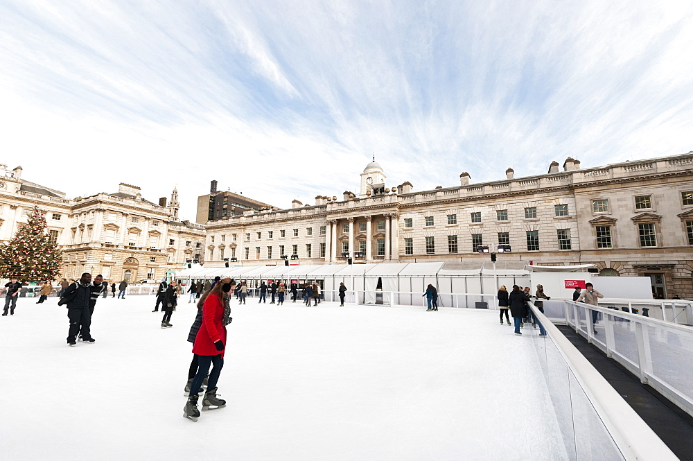 England, London, Skating on the seasonal ice rink at Somerset House.