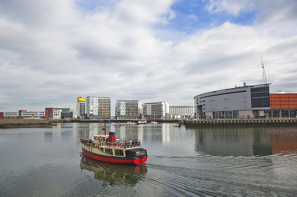 Ireland, North, Belfast, Titanic Quarter, tour boat taking tourists on sightseeing cruise.