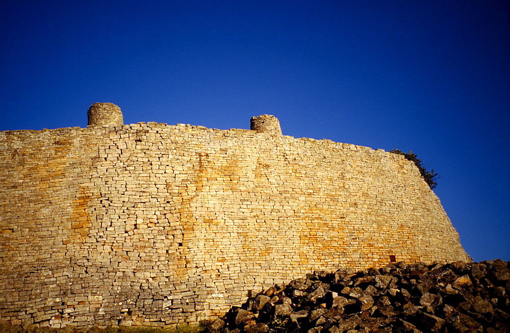 ZIMBABWE  Forts Great Zimbabwe Ruins. Towering stone wall of the abandoned city.