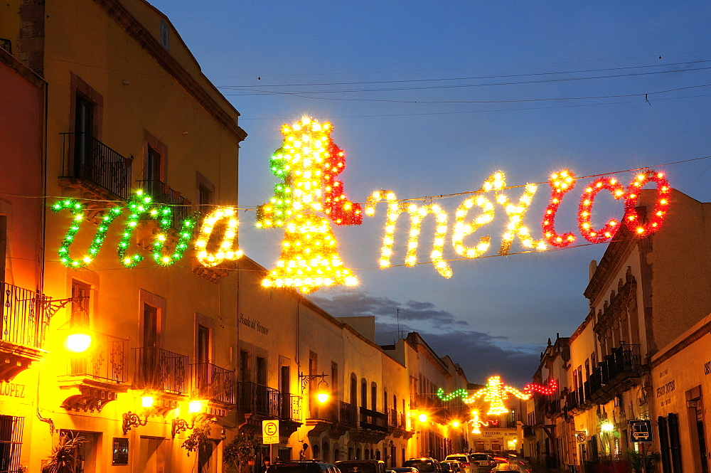 Mexico, Bajio, Zacatecas, Coloured lights hung across street for Independence Day celebrations.