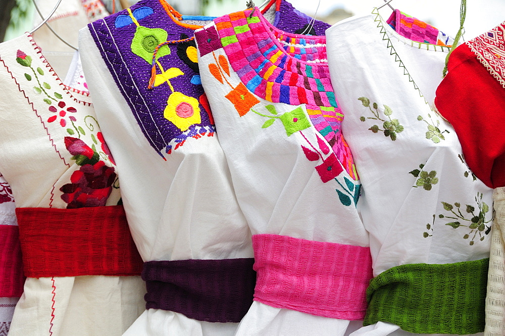 Mexico, Oaxaca, Hand embroidered blouses for sale.