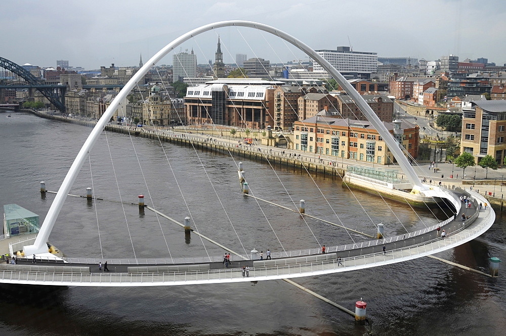 England, Tyneside, Gateshead, Millennium Bridge in closed position from the Baltic Arts Centre looking towards Newcastle Quayside and Newcastle upon Tyne city.