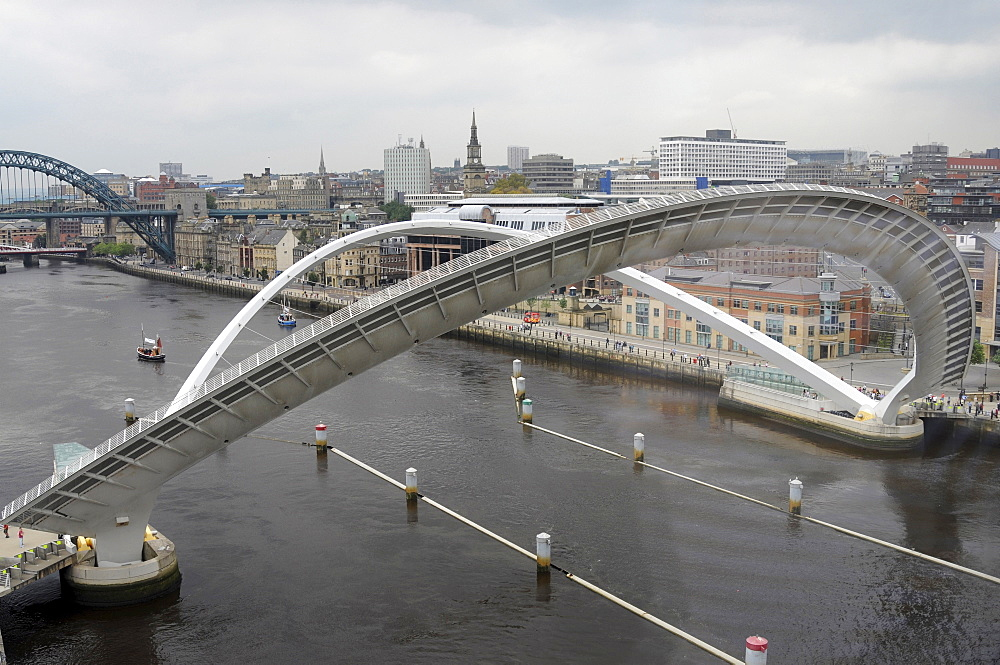 England, Tyneside, Gateshead, Millennium Bridge in open position from the Baltic Arts Centre looking towards Newcastle Quayside and Newcastle upon Tyne city.