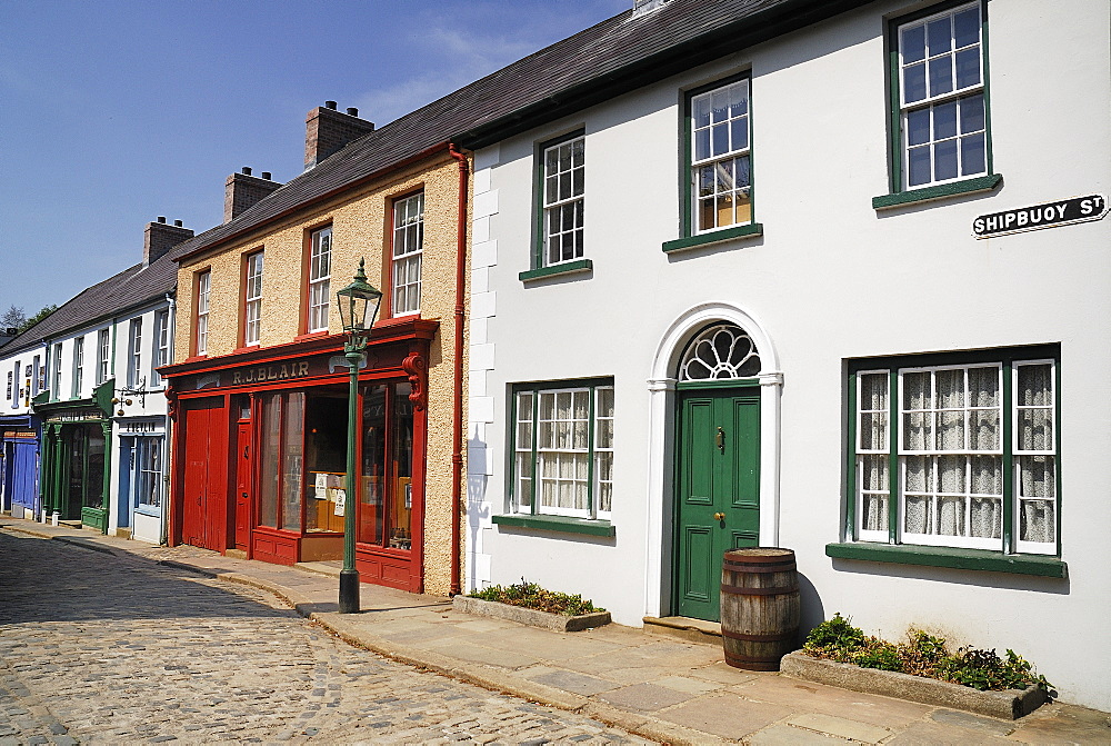 Ireland, County Tyrone, Omagh, Ulster American Folk Park 19th century street with Victorian shopfronts.