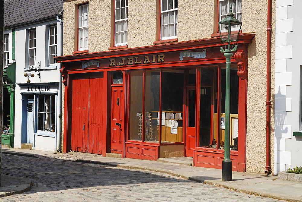 Ireland, County Tyrone, Omagh, Ulster American Folk Park 19th century street Blair stationers shopfront.