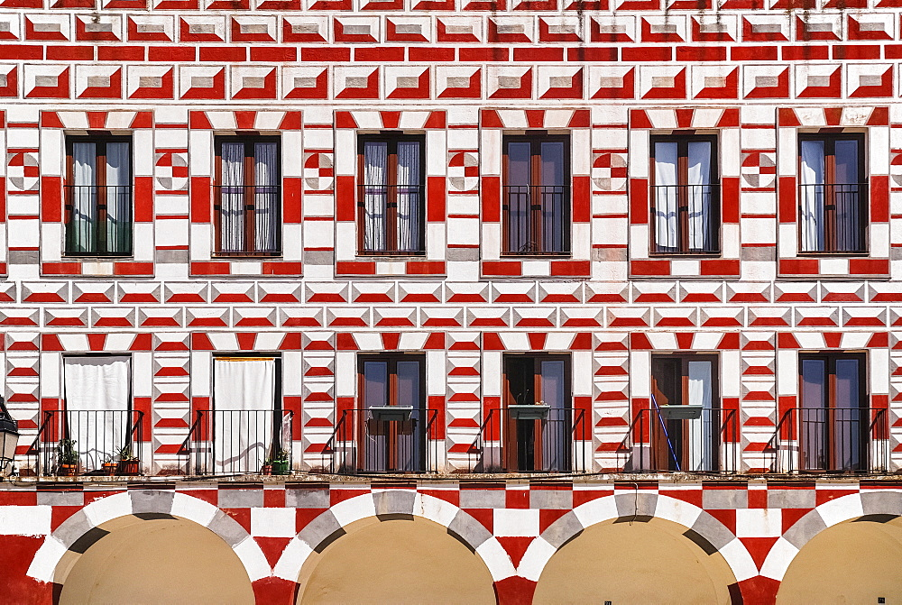 Spain, Extremadura, Badajoz, Colourfully painted exterior walls of building in Plaza Alta.
