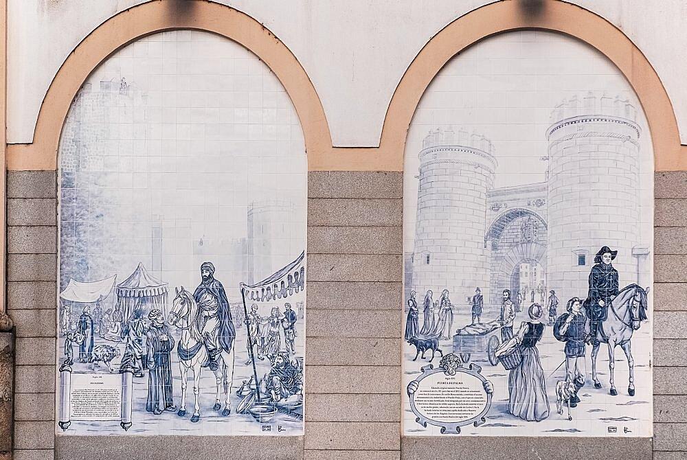 Spain, Extremadura, Badajoz, Tiled arches on building in Paseo de San Francisco showing Alcazaba and Puerta de Palmas.