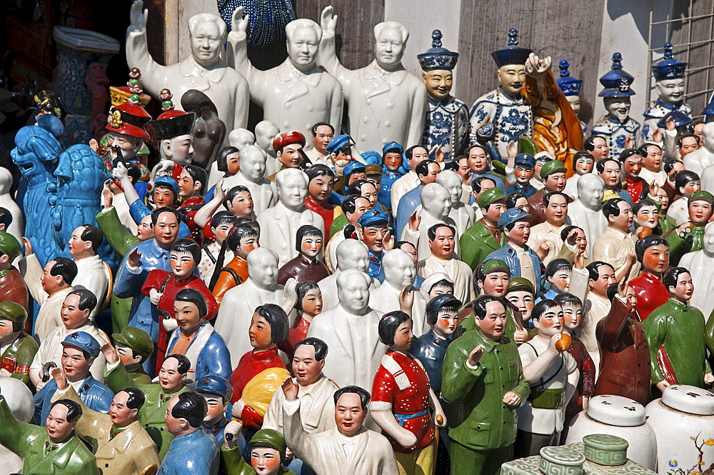 China, Shanghai, Porcelain figurines mainly of Chairman Mao Zedong but also of other Chinese communist leaders and Emperors and courtiers Memorabilia on sale at Dongtai antique market.