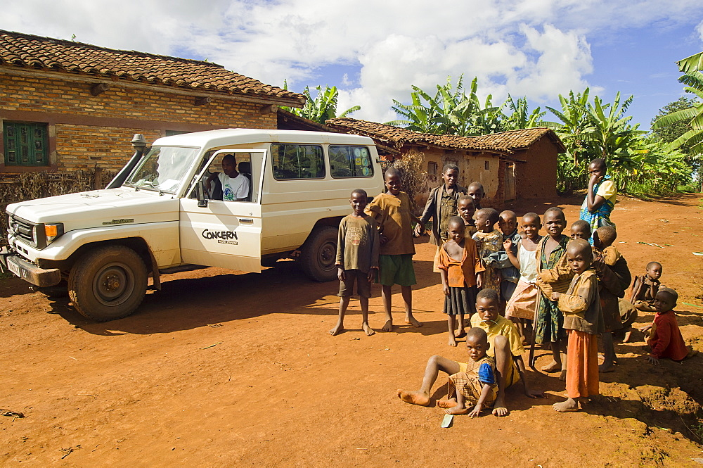 Rwanda, Children, Group of children on road beside a development project vehicle