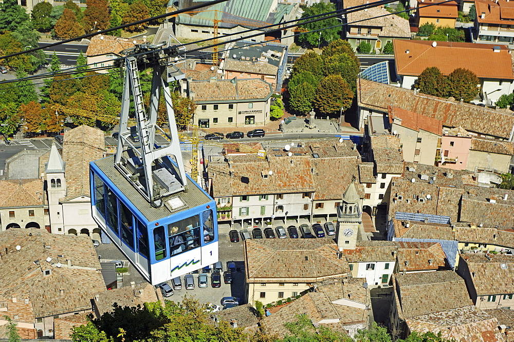 Republic of San Marino, San Marino City, Aerial Cable Car ride over city rooftops during the ascent to Monte Titano.