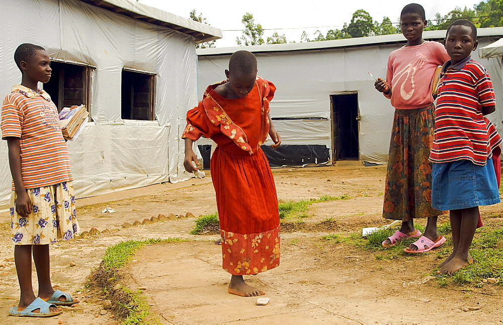 Burundi, Cibitoke Province, Mabayi, Primary School Girls playing hopscotch beside the Catch-up Class for children who have dropped out of school. Concern Worldwide has supported the establishment of a number of classes.