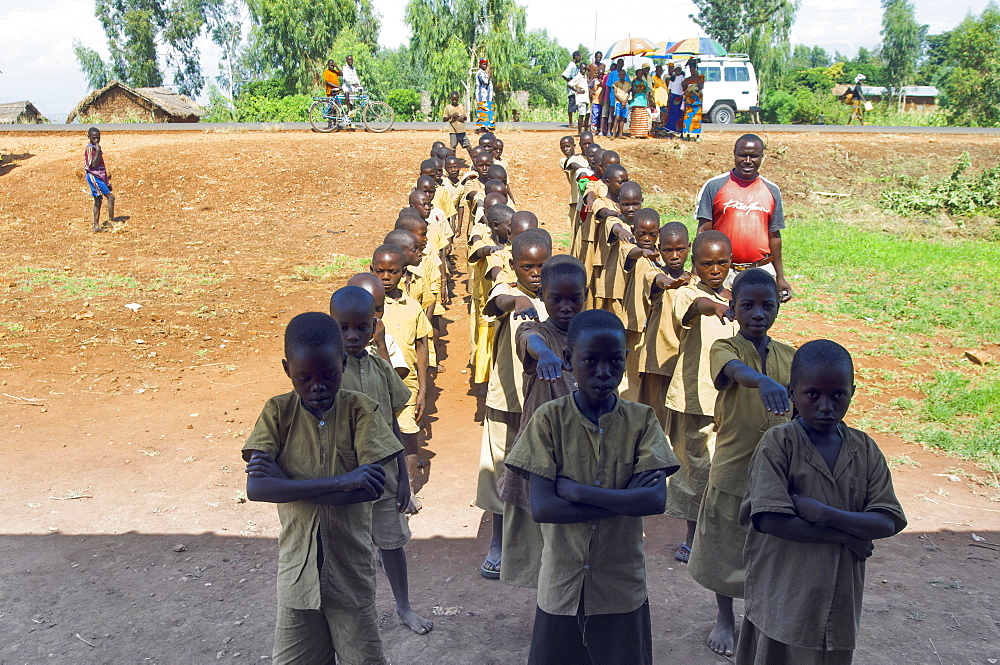 Burundi, Cibitoke Province, Buganda, Ruhagurika Primary Students lining up ready to go into their Catch-Up Class. Catch up classes were established by Concern Worldwide across a number of schools in Cibitoke to provide a second chance for children who had previously dropped out of school.