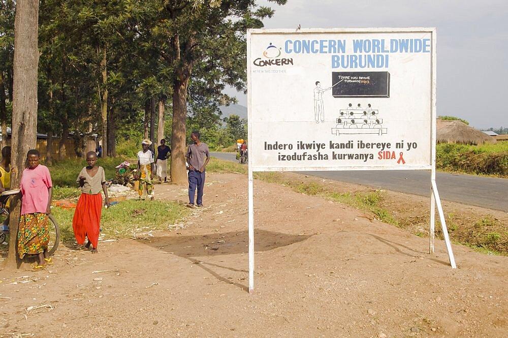 Burundi, Cibitoke Province, Buganda, Ndava Village Sign board beside the main road in Buganda Commune with HIV AIDS SIDA message.