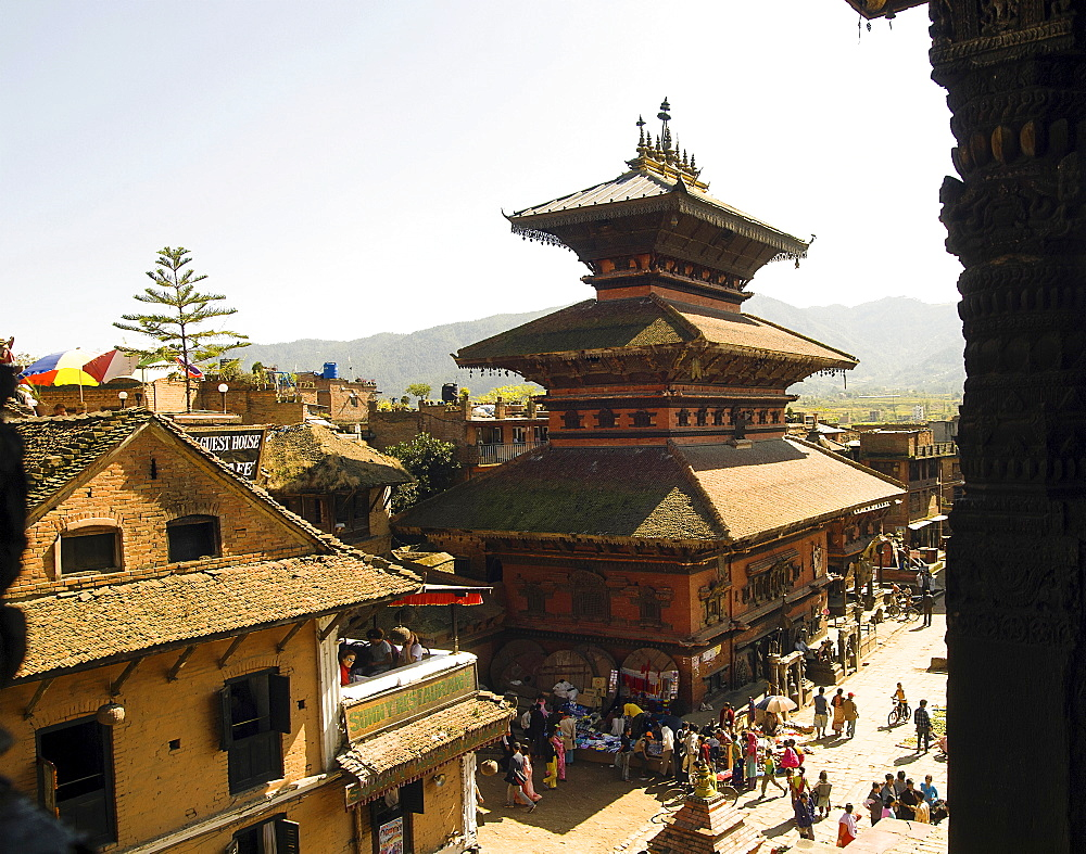 Nepal, Bhaktapur, Taumadhi Square View through pillars of temple of goddess Siddhi Laxmi.
