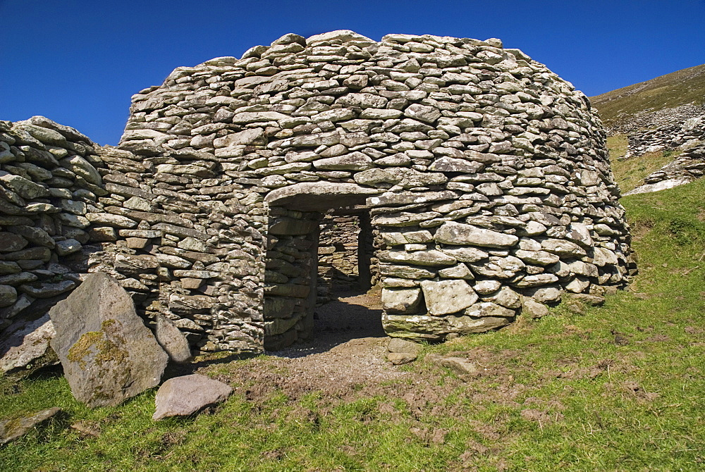 Ireland, County Kerry, Dingle Peninsula, Beehive hut in the Fahan Group.