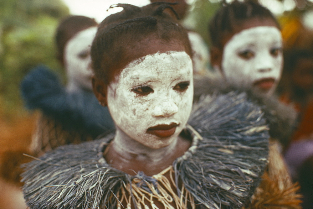SIERRA LEONE  Initiation Ceremony Portrait of girl initiate with white painted face.