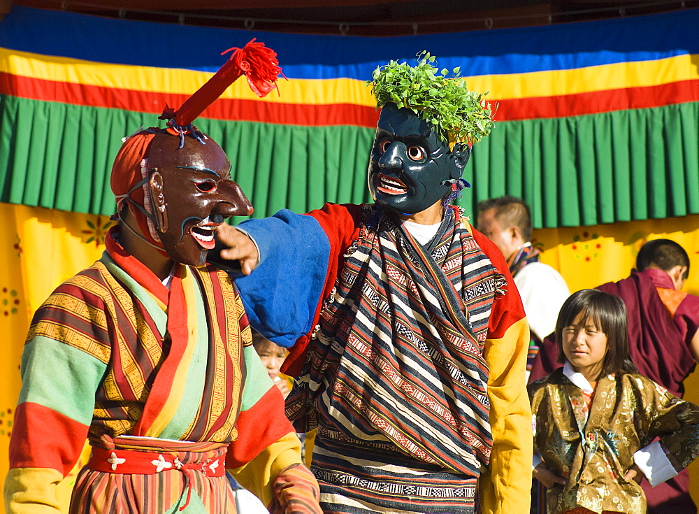 Bhutan, Thimpu Dzong, Two Atsaras, or comedians at a masked dance Tsecchu.