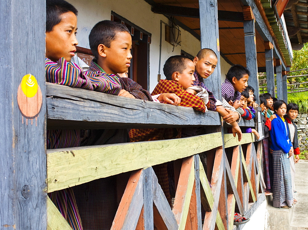 Bhutan, Mongar, Schoolchildren standing outside class.