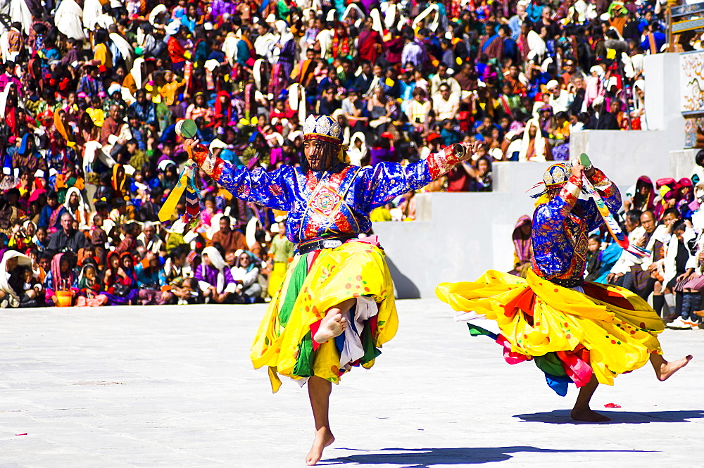 Bhutan, Thimphu Dzong, Dancers in traditional Buddhist costume for the Tsecchu, or Masked Dance.,