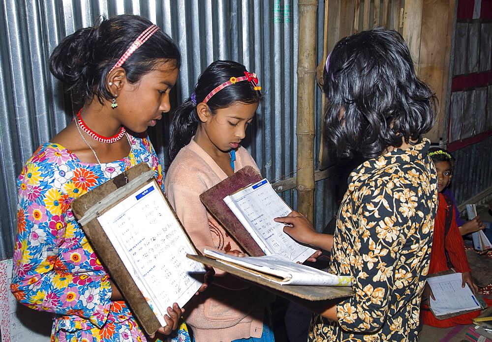 Bangladesh, Chittagong Division, Comilla, BRAC students in a primary classroom with peer marking.