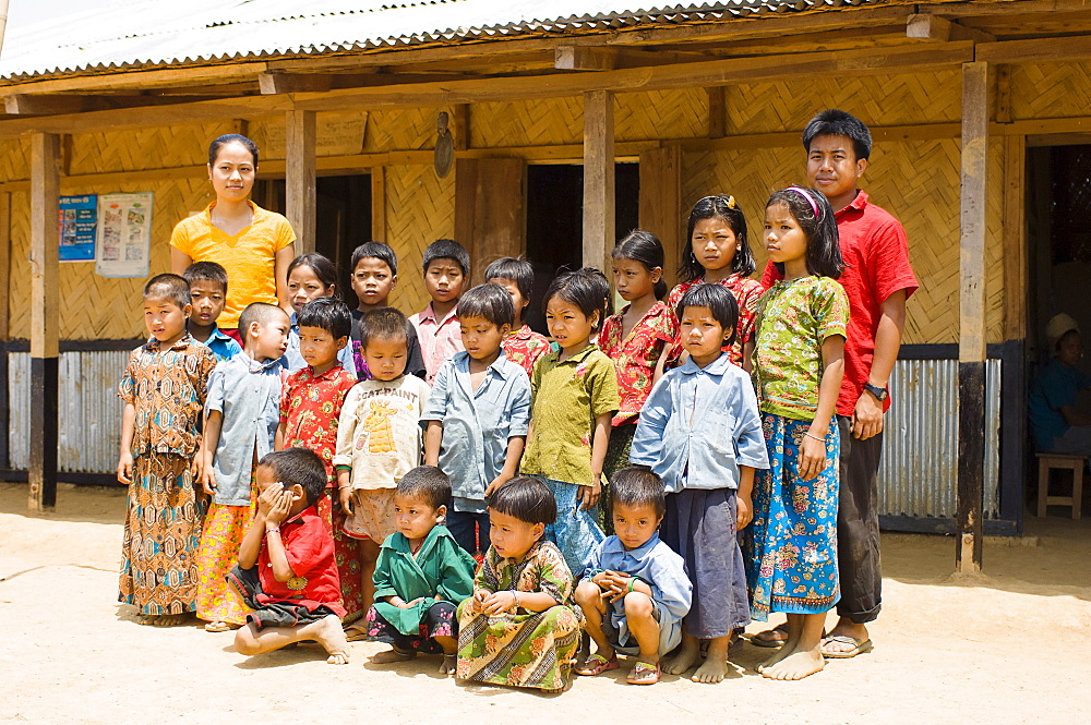Bangladesh, Chittagong Division, Bandarban, Students and teachers stood outside a small primary school in a remote area of the Chitagong Hill tracts.