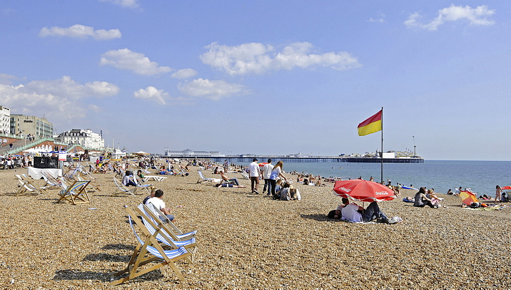 England, East Sussex, Brighton, View along the beach to Pier.