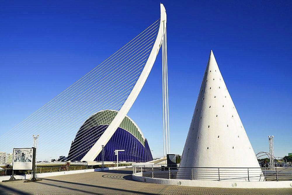 Spain, Valencia Province, Valencia, La Ciudad de las Artes y las Ciencias, City of Arts and Sciences,El Pont de l'Assut de l'Or Bridge and Agora with lift from Umbracle car park in foreground.,